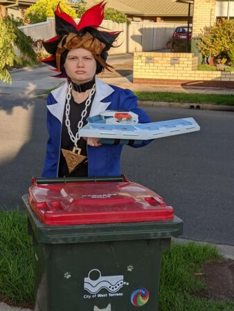 Leeanne dresses up as Yugi from the manga Yu-Gi-Oh! as part of bin isolation fun.