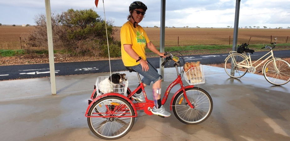 Jane on her bike on the bike trails in Kadina. Her two dogs are in the rear bike basket.